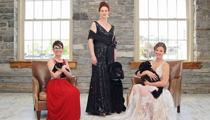 The Forever Gala - three women in ballgowns posed with animals.